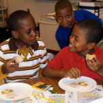 2nd Grade children eating healthy snacks